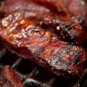 7645455-barbecue-beef-spare-ribs-cooking-on-a-grill-outdoors-in-summer